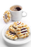 Cookies with jam and icing and cup of coffee Royalty Free Stock Photos
