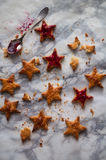 Cookies with jam in the shape of stars. Cookies stars, covered with berry jam royalty free stock photos
