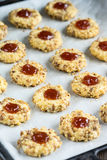 Cookies with jam and spoon Royalty Free Stock Photo