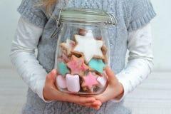 Cookies jar in child hands Stock Photo
