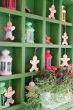 Cookies and lanterns on shelves. Cookies and green lanterns stand on shelves Royalty Free Stock Photography