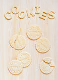Cookies and letters of shortcrust pastry on the table Stock Photos