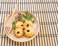 Cookies and lettuce leaves in wooden plate on wood table Royalty Free Stock Photo