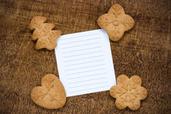 Cookies with a lined paper piece. Homemade cookies with  blank lined paper for text Royalty Free Stock Images