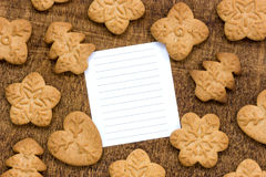 Cookies with a lined paper for text. Homemade cookies and blank lined paper for text Royalty Free Stock Photos