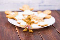 Cookies little men on a wooden table Royalty Free Stock Image