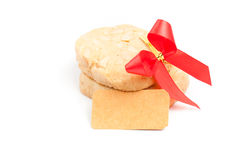 Cookies with macadamia nut and blank note on the white backgroun Royalty Free Stock Photos