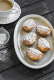 Cookies madeleines with powdered sugar on oval plate Stock Photo
