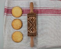 Cookies making concept, embossing roller, ready patterned shortbread, top view, royalty free stock photography