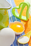 Cookies making: eggs, jug, milk, salt and form. Cookies making: fresh eggs, green jug, milk, salt and cookie form Stock Images