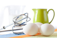 Cookies making: eggs, jug, spoons, form. Cookies making: fresh eggs, green jug, milk and mixer Stock Photography