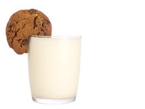 Cookies and milk. Chocolate cookie on a glass of milk as if a slice of lemon Stock Photos