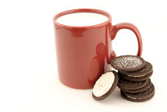Cookies and milk. Cookies and a cup of milk stock photos