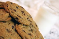 Cookies and milk. A plate of chocolate chip cookies and a glass of milk Stock Photos