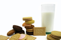 Cookies and Milk. A glass of milk and several type of cookies are displayed. (The word SOCIAL on the cookie refer to a type of cookie made by several companies Royalty Free Stock Images