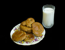 Cookies and milk. On a black background Royalty Free Stock Images