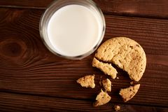 Cookies and milk. Chocolate chip cookies and a glass of milk. Vintage look. Tasty cookies and glass of milk on rustic wooden background. Food, junk-food stock image
