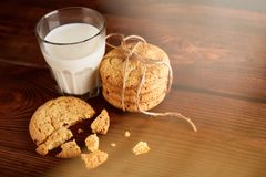 Cookies and milk. Chocolate chip cookies and a glass of milk. Vintage look. Tasty cookies and glass of milk on rustic wooden background. Food, junk-food stock photos