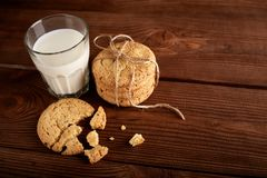 Cookies and milk. Chocolate chip cookies and a glass of milk. Vintage look. Tasty cookies and glass of milk on rustic wooden background. Food, junk-food royalty free stock photo