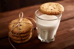 Cookies and milk. Chocolate chip cookies and a glass of milk. Vintage look. Tasty cookies and glass of milk. On rustic wooden background. Food, junk-food stock photo