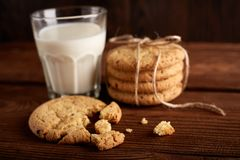 Cookies and milk. Chocolate chip cookies and a glass of milk. Vintage look. Tasty cookies and glass of milk. On rustic wooden background. Food, junk-food stock images