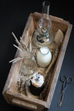 Cookies with Milk, Dried Flowers and an Oil Lamp in a Wooden Box. Moody Background Stock Photos