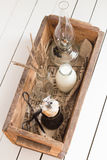 Cookies with Milk, Dried Flowers and an Oil Lamp in a Wooden Box. White Wooden Table Background Stock Photos