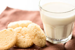 Cookies and milk in glass close up Stock Photography