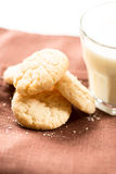 Cookies and milk in glass on napkin vertical Stock Photos