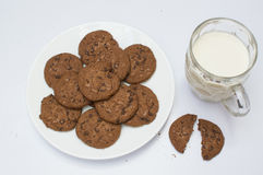 Cookies and milk. Cookies and glass of milk on white background Royalty Free Stock Images