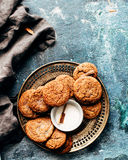 Cookies and Milk on Plate Near a Black Textile Stock Photo