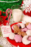 Cookies and milk for santa. Cookies and glass of hot milk waiting for santa claus on the table Stock Photo