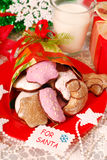 Cookies and milk for santa. Cookies and glass of hot milk waiting for santa claus on the table Royalty Free Stock Photo