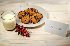 Cookies and milk for Santa Claus. Close to treat is a card with a note. Stock Image