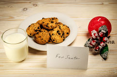 Cookies and milk for Santa Claus on a wooden table. Stock Images