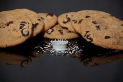 Cookies and Milk Splash Stock Photos