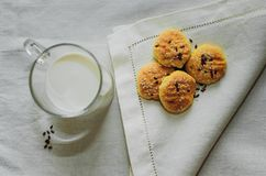 Cookies and milk are on a white tablecloth stock images