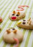 Cookies with mouse shaped and red licorice tail stock photos