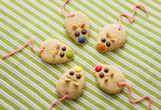 Cookies with mouse shaped and red licorice tail royalty free stock photo