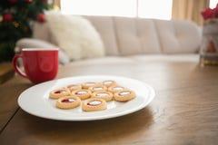 Cookies and mug on coffee table at christmas Stock Photos