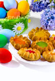 Cookies and multi-colored eggs Royalty Free Stock Photography