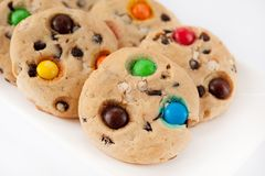 Cookies with multi-colored jelly beans on a white rectangular pl stock photo