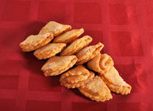 Cookies оn a claret cloth. Cookies lie on a claret cloth Royalty Free Stock Image
