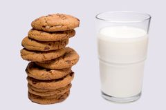 Cookies n' Milk. Pile of chocolate chip cookies and glass of milk Stock Photography