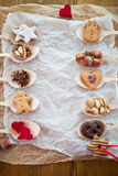 Cookies and nuts for christmas on wooden spoons Stock Photography