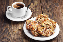 Cookies with nuts and coffee Stock Images