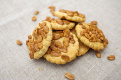 Cookies with nuts. Delicious walnut cookies on a linen servo Stock Images