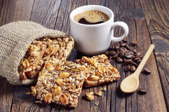 Cookies with nuts in sack and coffee Royalty Free Stock Photos