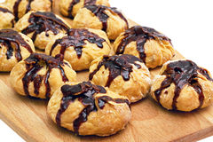 Cookies with nuts watered chocolate Royalty Free Stock Photography