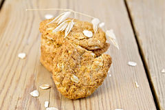 Cookies oatmeal with spikelet on board Royalty Free Stock Photo